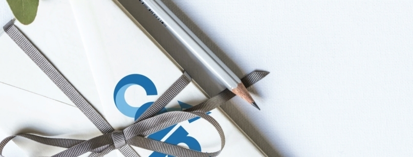 CAP envelope with ribbon and pencil