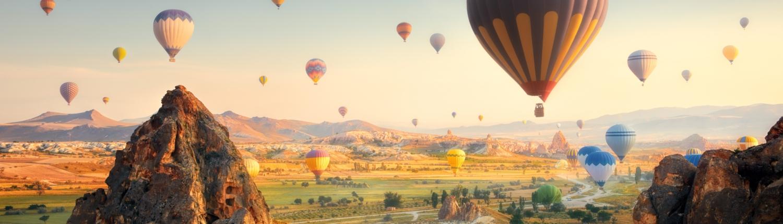 CAP Hot Air Balloons Flying at Sunset, Cappadocia, Turkey.